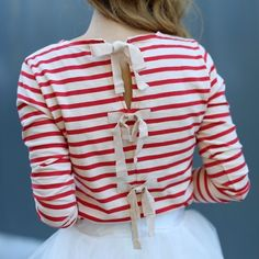 Jcrew striped shirt with bow-embellished back A fun holiday twist on the classic striped T-shirt, featuring grosgrain ribbon bows with a hint of shimmer along the back. NWT. Cotton. Bracelet sleeves. Hand wash. Import. J. Crew Tops