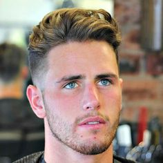Medium Length Brushed Back Hair with Low Fade