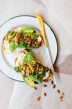 The ultimate Fall Avocado Toast with ricotta, kale pesto, pepitas, and habanero Harvest Snaps.