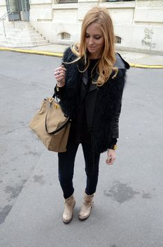 love how Chiara rocks light boots with dark jeans/jacket