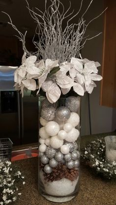 Poinsettias arrangement in a vase with layer of faux snow,pinecones, white and silver balls. Poinsettias arrangement in a vase with layer of faux snow,pinecones, white and silver balls. Christmas Vases, Christmas Flower Arrangements, Silver Christmas Decorations, Christmas Table Centerpieces, Christmas Holidays, Christmas Wreaths, Holiday Decor, Elegant Christmas Trees, Creation Deco