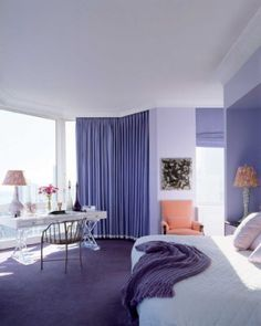 Jamie Drake turned the bedroom of this Manhattan apartment into a soothing retreat with hues of periwinkle and lavender on the windows, walls, and floor.