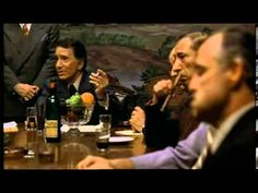 """In this scene from """"The Godfather""""  we see the meeting of the five families. This is a meeting that takes place between all of the Italian American Mafia leaders in the New York area. This is a typical representation of Whites partaking in criminal activity. They are generally shown in organized crime groups as opposed to African Americans who are generally portrayed as street thugs. (observation)"""