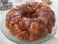 4 cans of Pillsbury Biscuits   1/2 cup of melted butter   3/4 cup of packed brown sugar   3/4 cup of granulated sugar   2 TBSP g...