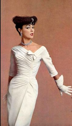 Ivy Nicholson wearing a rayon crêpe dress by Jacques Fath, photo by Jacques Decaux, 1956.