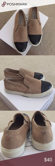 Suede slip on Steve Madden shoes Lightly worn once, no flaws. Super comfy and stylish. The tan part is suede the black part is faux leather. Steve Madden Shoes Sneakers