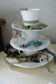 Jewellery holder made from teacups and plates.