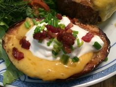 Oh yeah! The top of my blooming baked potato with Tillamook cheddar, Niman Ranch bacon, Kalona sour cream, and chives.