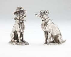 Two Victorian sterling silver novelty dog-form condiments, Both London, each with removable heads, the first: makers mark ''JBH'' (James Barclay Hennell), date marked 1880, modeled as Mr. Punch's dog Toby, wearing a hat and neck ruff; the second: with maker's mark ''HSB'', underside of body inscribed with name of London retailer: ''MacMichael, S. Audley St, W'', modeled as an unclothed hound.