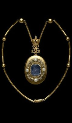 Empress Eugénie's Locket Pendant.Gold oval locket, the cover set with a sapphire cameo of a Muse with lyre, framed in diamonds, within a diamond and pearl laurel wreath. Inside there is a glazed compartment containing a photograph of the Empress Eugénie. The locket is attached by a gold double E (for Eugénie) cipher surmounted by the Napoleonic Imperial crown to a gold chain interspersed with globes