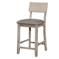 The Jace Gray Wash Bar Stool has a simple design that easily lends itself to a variety of home décor styles. The stool features a rectangular back and soft rustic gray wash finish, with a cushioned seat upholstered in linen.