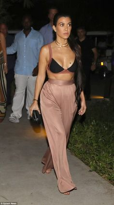 A 10LKourtney also looked very comely in her outfit. The ex of Scott Disick had on a black and mauve bra top with dusty rose silky slacks and pink heels with a black clutch