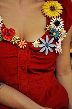 A look I plan to steal: bunches of vintage brooches around the neckline of a dress.