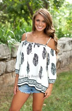 Our soft Bohemian Rhapsody Blouse fits off the shoulder and drapes perfectly down the body.