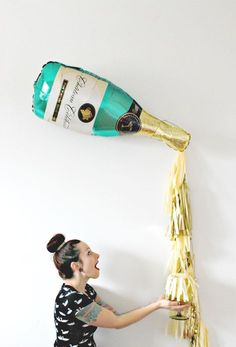 New Years Eve Champagne Bottle Tassel Balloon, New Years Eve Decor, Photo Booth Prop, Gold and Champagne Backdrop, Pop Clink Fizz by pomtree on Etsy https://www.etsy.com/listing/257385059/new-years-eve-champagne-bottle-tassel