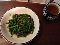 Missed cooking our own dinners: wild rice with grape seed oil sauteed onions, garlic and asparagus served with olive oil and lemon juice, sea salt and cracked pepper. Green tea on the side. Cracked Pepper, Saute Onions, Wild Rice, Seed Oil, Sea Salt, Asparagus, Green Beans, Olive Oil, Garlic