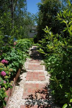 The light, soft feel of crushed stone pairs well with heavier brick for a nice juxtaposition of color and pattern that really pops in a garden.