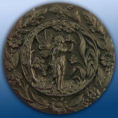 Antique fairy button.