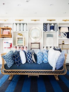 """The only room that serves primarily as retail display space, the main floor area showcases the brand's signature pillows, rugs, lamps, mirrors, and end tables. When customers step inside this store, Dugan hopes the feeling they'll have is """"I want to live here."""""""
