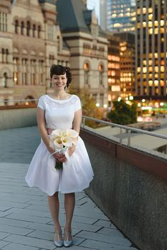 Mallory and Chris's 11 Guest, $4000 Toronto City Hall Wedding. Photographer Jessilyn Wong. See more.... @intimateweddings.com #weddingdress