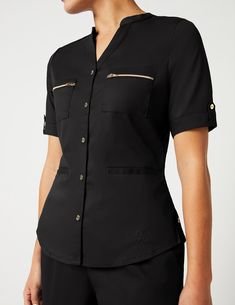 Button Down Top in Black is a contemporary addition to women's medical scrub outfits. Shop Jaanuu for scrubs, lab coats and other medical apparel. Scrubs Outfit, Pullover Mode, Lab Coats, Medical Scrubs, Peeling, Scrub Tops, Sweater Fashion, Chef Jackets, Men Casual