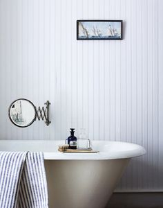 Love the beadboard walls, tub, and mirror.  Gotta save this one for future b/r remodel!
