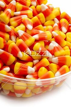 candy corn close up - Close up picture of candy corn in a transparent bowl.