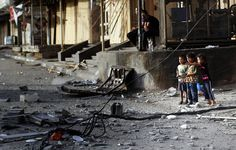 Fifty-two killed as Israel bombs charity, mosques, homes in Gaza's bloodiest day. Palestinian children look at the rubble of a destroyed mosque following an Israeli military strike in the Nusseirat refugee camp in the central Gaza Strip, on July 12, 2014. (Photo: AFP - Thomas Coex)  Published Saturday, July 12, 2014