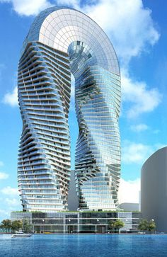 The DNA Towers | Abu Dhabi - the twin towers will comprise both residences and offices facing the ocean, affording spectacular views. The towers are seemingly joined at the top by a lopping structure of glass and steel. Love this building. Visit Bone Yard Bakery for all those gourmet organic free dog treats www.boneyardbakery.net