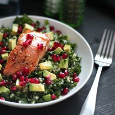 Superfood Salad highlighting five super foods: kale, quinoa, avocado, pomegranate, and wild salmon. Tossed in a honey mustard vinaigrette.