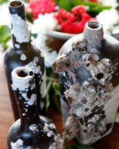 Barnacle encrusted bottles. Barnacles are small shellfish that attach ...