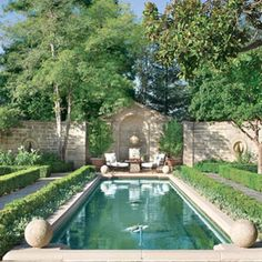 Narrow pool with sitting area at one end