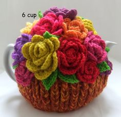 """The bottom half of the main body of this beautifully hand crafted 4 cup tea cosy is knitted in quadruple (nice and thick) multi black sparkly wool to form the """"flowerpot"""" and the top half in multi greens randomly embellished all over with mul. Knitting For Kids, Hand Knitting, Knitting Patterns, Rose Basket, Baby Door, Autumn Rose, Seasonal Celebration, Tea Cosies, Crocheted Lace"""