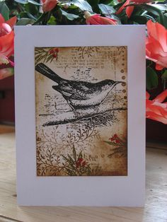 Lovely bird card...I love the black ink stamping with the vintage accent and just a bit of color....very nice