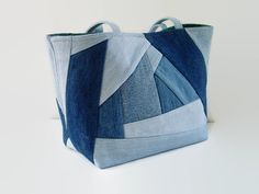 Tote bag, handbag or shoulder bag/purse made out of a variety of upcycled recycled repurposed denim blue jeans and cotton fabric was used to create this unique Crazy Quilt bag. This medium size bag is perfect for carrying all your daily needs, books, magazines or projects. Add a favorite pin to coordinate with your outfit. The front and back exterior denim pieces have been uniquely pieced together Crazy Quilt patchwork style differently which gives each side an original appearance. This bag…