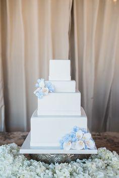 Square four tier wedding cake with calla lily embellishmentsL Photography: Jillian Rose Photography - www.jillianrosephotography.com Read More on SMP: http://www.stylemepretty.com/2016/09/12/villa-mara-malibu-wedding/