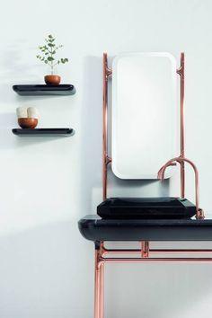 Use copper accessories to add a twist to a boring bathroom.