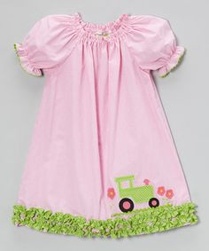 This frilly frock with its whimsical appliqué will have little ladies looking perfectly pretty for parties and playtime. Puff sleeves and a gathered neckline add girly charm to its silhouette that swings with ruffles dancing along the bottom.