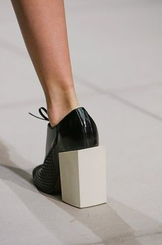 Chunk Heel At Balenciaga SS13. Please don't wear these around innocent children . Horrible !!!