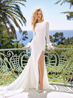 mermaid crepe wedding dress with long sleeves and feather appliques