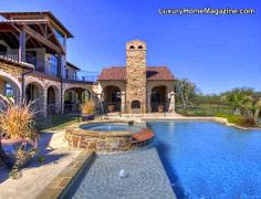 Stunning estate on 70 acres with infinity pool with sandy beach, extensive outdoor | backyard living with outdoor kitchen and fireplace. Amazing custom home | house. Beautiful patio and spa.