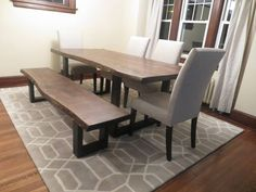 This dining table was created by using live edge walnut. Both the table and bench have matching steel legs.