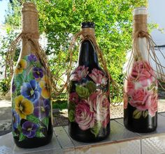 Decorated bottles with decoupage by Carlos Rossi