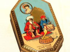 English Dainty Dinah Fakir India Snake Chocolate Toffee Candy Tin 1920s