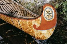 Decorative root sewing on bow of 18' fur-trade type birchbark canoe with typical painted ends ; made by Henri Vaillancourt 2004