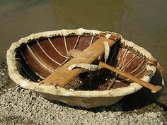 Coracle- a small round boat of Welsh origin. Very small, very light. The framework is traditionally covered with animal skins.