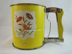 Vintage Androck Hand-i-Sift 3 three-screen yellow flour sifter with floral design. Made in the USA.