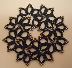 """Mary Konior's """"Posy"""" from """"Tatting with Visual Patterns"""" with beads. Very different look... pretty :)"""