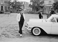 """.../"""" Elvis walking past his Cadillac Eldorado on the set of his second movie 'Loving You' which was filmed at Paramount Studios in Hollywood, CA from January 14 to March 16, 1957"""". Tanja Graf' quote. Grateful!"""