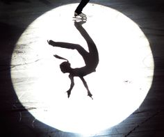 Silhouette of Kim Yuna performing a spin.